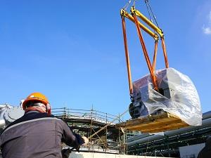 Crane Lifting Load Near Construction Area