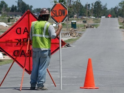 Flagger in Work Zone Holding Stop/Slow Sign