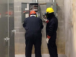 Two Electrical Workers