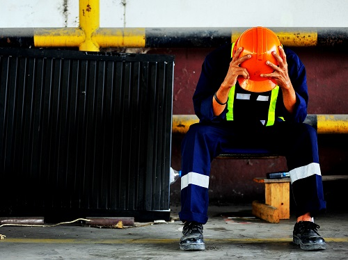 Construction Worker Having a Stressful Day