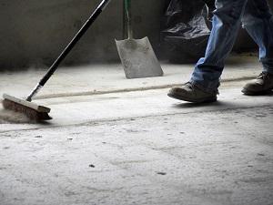 Worker Wearing Work Boots, Sweeping Up Floor