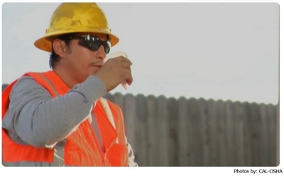Construction Worker Taking a Break to Drink Water
