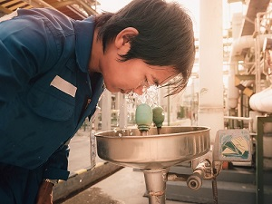 Industrial Worker Using Eye Wash Station
