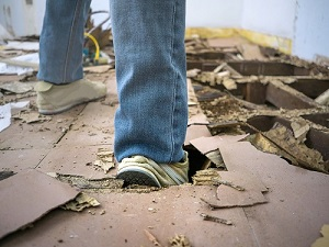 Person Stepping into Construction Floor Hole