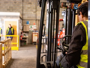 Forklift Driver, Two Workers in Safe Area Away from Forklift