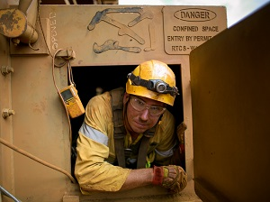 Worker Climbing Out of Permit-Required Confined Space