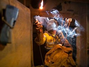 Worker Welding Inside Confined Space