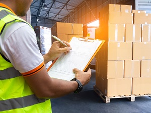 Warehouse Worker Completing Inventory in Warehouse