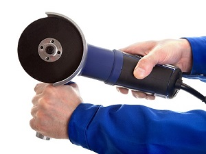 Person Holding Portable Grinder with Two Hands