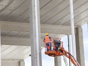 Worker in Aerial Lifting Painting Bridge but Not Wearing Fall Protection