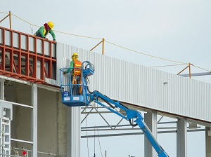 Worker in Aerial Lift at Construction Site