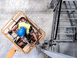 Aerial View of Construction Worker in Man Lift