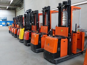 Forklifts, Parked in Large Warehouse