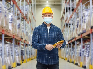 Warehouse Worker Wearing Hardhat and Face Mask