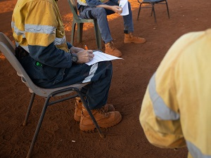 Construction Workers Having Safety Meeting Outdoors Spaced 6 Feet Apart