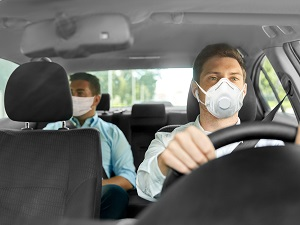 Two People in Car Both Wearing Masks