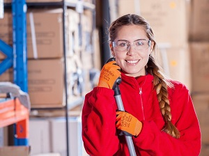 Happy Warehouse Worker Wearing Safety Glasses and Gloves