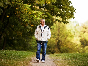 Older Gentleman Taking a Walk in the Park
