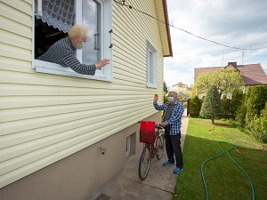 Neighbor on Bike Visiting Elderly Neighbor, Social Distancing, Wearing Masks