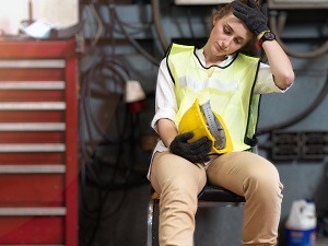 Industrial Worker is Sitting, Feeling Tired