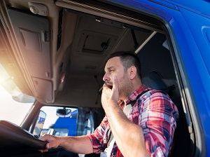 Truck Driver Yawning While Driving