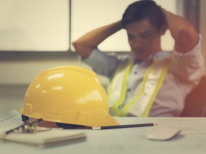 Construction Worker Feeling Tired, Sitting at Desk