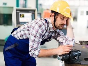 Industrial Worker Falling Asleep at Work