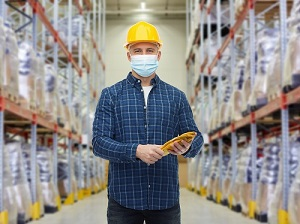 Warehouse Worker Wearing Hardhat and Gloves