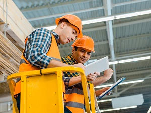 Two Workers Conducting Scissor Lift Inspection