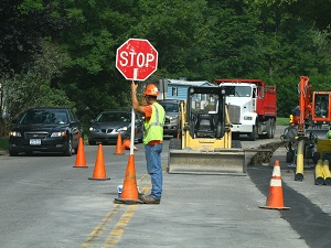 Work Zone Flagger Holding Stop Sign Directing Traffic