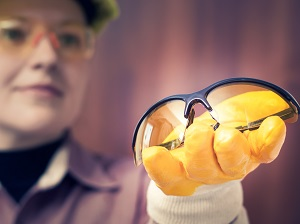 Professional Handing Safety Glasses to Co-Worker to Wear