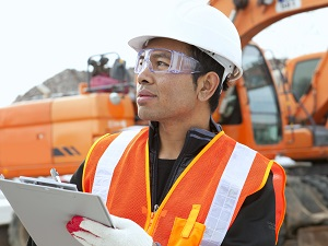 Construction Inspector Wearing Safety Glasses on Jobsite