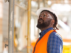 Worker Wearing PPE Including Safety Glasses