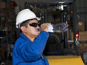 Worker Drinking Bottled Water