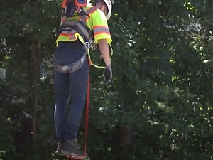Worker in PFAS Demonstrating Use of Foot Strap While Suspended