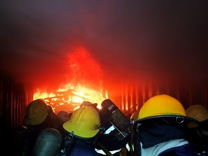 Rescuers in Confined Space with Fire Burning