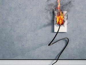 Extension Cord Plugged into Wall Socket on Fire
