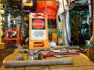 Danger Hot Work Sign in Busy Machine Shop