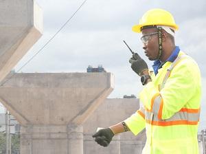 Worker Wearing PPE with Walkie-Talkie