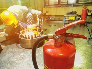 Welder with Fire Extinguishers Nearby