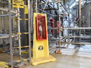 Fire Extinguisher in Portable Cabinet in Industrial Plant