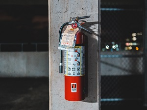 Fire Extinguisher on Concrete Post