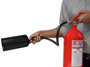 Person Holding a Portable Fire Extinguisher, Ready to Use