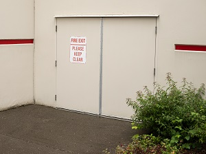 Fire Exit Doors, View from Outside Facility, Clearly Marked with Sign that Says Please Keep Clear