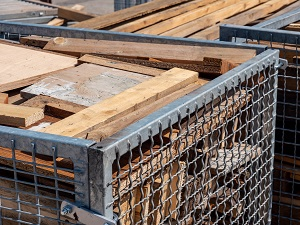 Larger Containers to Collect Lumber Scraps on Construction Site