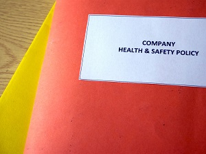 Folders that say Company Health and Safety Policy