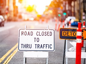 Road Closed to Thru Traffic and Detour Sign