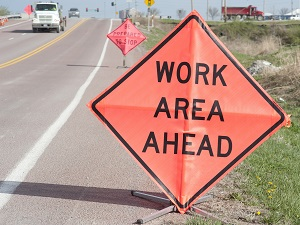 Work Area Ahead Sign on Busy Roadway