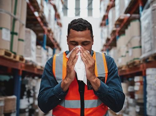 Warehouse Worker Sneezing
