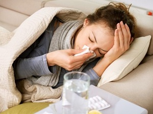 Sick Woman Laying on Couch